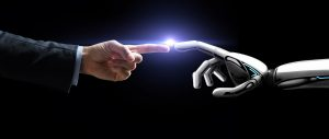 background image of human hand touching computer hand